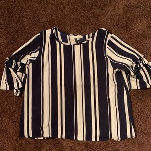 Blue and white striped blouse, size runs small